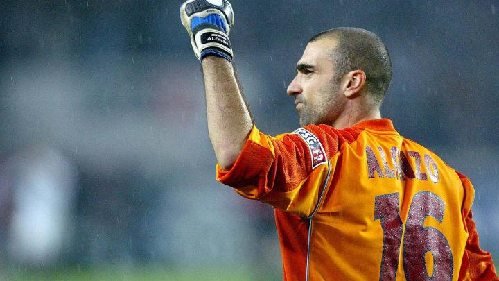 PSG's goalkeeper Jerome Alonzo raises hi