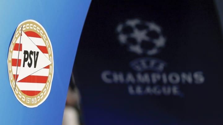 PSV Eindhoven logosu ve arka bölümde Şampiyonlar Ligi logosu