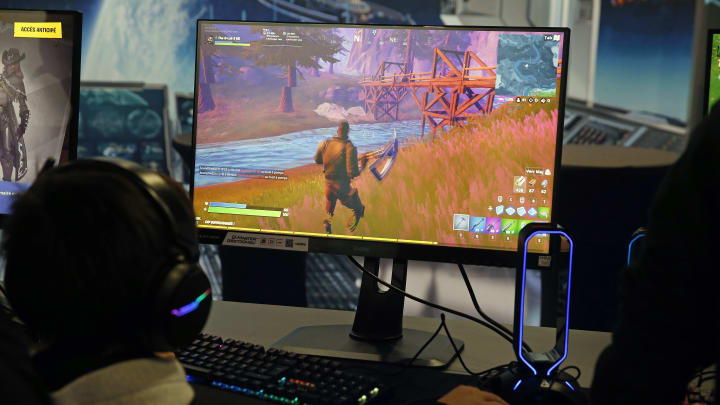 PARIS, FRANCE - OCTOBER 29: A gamer plays the video game 'Fortnite' developed by Epic Games during the 'Paris Games Week' on October 29, 2019 in Paris, France. 'Paris Games Week' is an international trade fair for video games that runs from October 29 to November 03, 2019. (Photo by Chesnot/Getty Images)