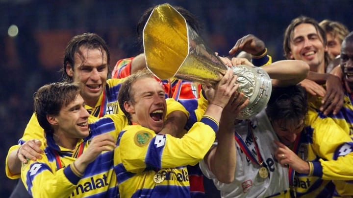 Parma's players celebrate with their trophy after