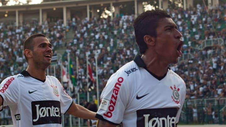 Paulinho (R) and Leandro Castan of Corin