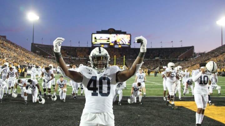 IOWA CITY, IOWA - OCTOBER 12:  Linebacker Jesse Luketa #40 of the Penn State Nittany Lions taunts fans before the match-up against the Iowa Hawkeyes, on October 12, 2019 at Kinnick Stadium in Iowa City, Iowa. (Photo by Matthew Holst/Getty Images)