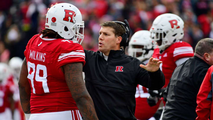 PISCATAWAY, NJ - NOVEMBER 17: Head coach Chris Ash of the Rutgers Scarlet Knights coaches Kevin Wilkins #99 against the Penn State Nittany Lions during the second quarter at HighPoint.com Stadium on November 17, 2018 in Piscataway, New Jersey. (Photo by Corey Perrine/Getty Images)