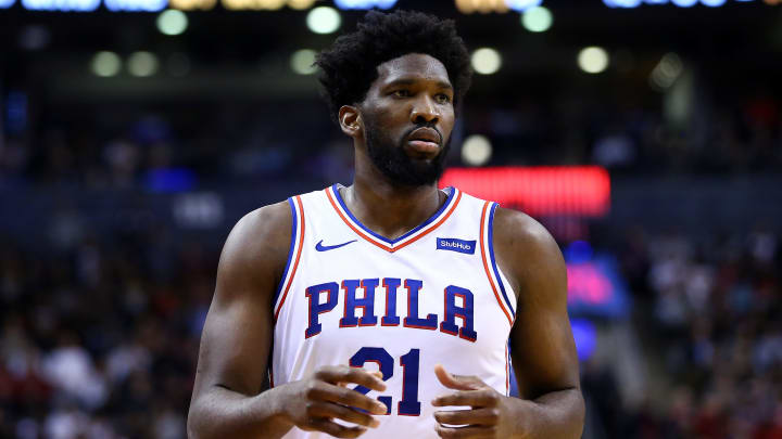 TORONTO, ON - NOVEMBER 25:  Joel Embiid #21 of the Philadelphia 76ers looks on during the second half of an NBA game against the Toronto Raptors at Scotiabank Arena on November 25, 2019 in Toronto, Canada.  NOTE TO USER: User expressly acknowledges and agrees that, by downloading and or using this photograph, User is consenting to the terms and conditions of the Getty Images License Agreement.  (Photo by Vaughn Ridley/Getty Images)