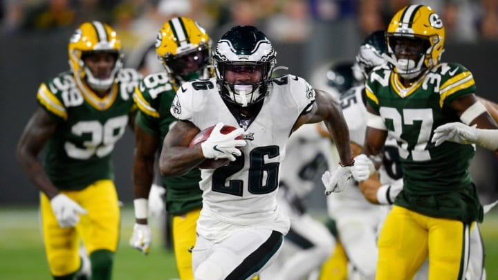 GREEN BAY, WISCONSIN - SEPTEMBER 26: Miles Sanders #26 of the Philadelphia Eagles runs with the football in the second quarter against  Josh Jackson #37 of the Green Bay Packers at Lambeau Field on September 26, 2019 in Green Bay, Wisconsin. (Photo by Quinn Harris/Getty Images)