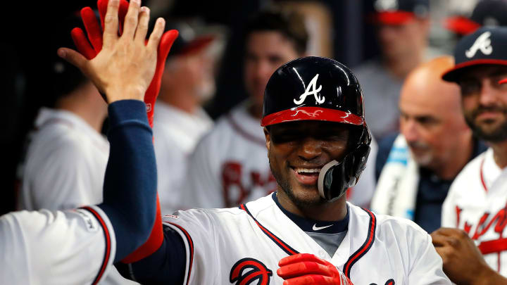 ATLANTA, GEORGIA - SEPTEMBER 17:  Adeiny Hechavarria #24 of the Atlanta Braves reacts after hitting a solo homer in the eighth inning against the Philadelphia Phillies at SunTrust Park on September 17, 2019 in Atlanta, Georgia. (Photo by Kevin C. Cox/Getty Images)