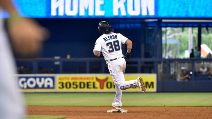 MIAMI, FL - JUNE 30: Jorge Alfaro #38 of the Miami Marlins rounds second base after hitting a home run in the sixth inning against the Philadelphia Phillies at Marlins Park on June 30, 2019 in Miami, Florida. (Photo by Eric Espada/Getty Images)