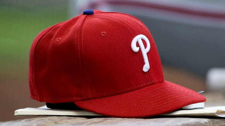MILWAUKEE, WI - APRIL 24:  A Philadelphia Phillies baseball hat sits in the dugout during the game against the Milwaukee Brewers at Miller Park on April 24, 2016 in Milwaukee, Wisconsin. (Photo by Dylan Buell/Getty Images) *** Local Caption ***