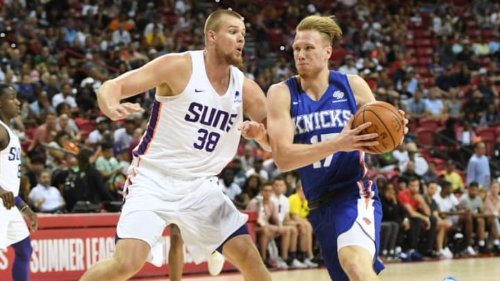 LAS VEGAS, NEVADA - JULY 07:  Ignas Brazdeikis #17 of the New York Knicks drives against Jack Salt #38 of the Phoenix Suns during the 2019 NBA Summer League at the Thomas & Mack Center on July 7, 2019 in Las Vegas, Nevada. NOTE TO USER: User expressly acknowledges and agrees that, by downloading and or using this photograph, User is consenting to the terms and conditions of the Getty Images License Agreement.  (Photo by Ethan Miller/Getty Images)