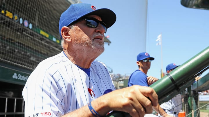 CHICAGO, ILLINOIS - JULY 12: Manager Joe Maddon #70 of the Chicago Cubs watches as his team takes on the Pittsburgh Pirates at Wrigley Field on July 12, 2019 in Chicago, Illinois. (Photo by Jonathan Daniel/Getty Images)