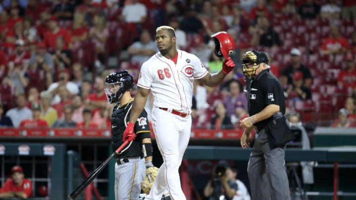 CINCINNATI, OHIO - JULY 30: Yasiel Puig #66 of the Cincinnati Reds disagrees with a called strike in the 8th inning against the Pittsburgh Pirates at Great American Ball Park on July 30, 2019 in Cincinnati, Ohio. (Photo by Andy Lyons/Getty Images)