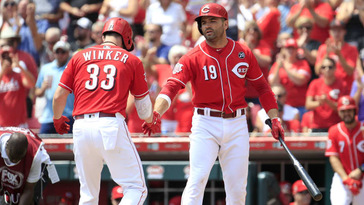 CINCINNATI, OHIO - JULY 31: Jesse Winker #33 of the Cincinnati Reds is congratulated by Joey Votto #19 after hitting a home run in the first inning against the Pittsburgh Pirates at Great American Ball Park on July 31, 2019 in Cincinnati, Ohio. (Photo by Andy Lyons/Getty Images)