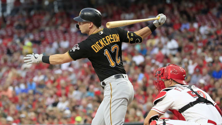 CINCINNATI, OHIO - JULY 30:  Corey Dickerson #12 of the Pittsburgh Pirates hits a two RBI single in the third inning against the Cincinnati Reds at Great American Ball Park on July 30, 2019 in Cincinnati, Ohio. (Photo by Andy Lyons/Getty Images)