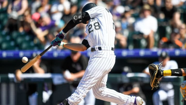 DENVER, CO - SEPTEMBER 1:  Nolan Arenado #28 of the Colorado Rockies connects for a sixth inning solo home run against the Pittsburgh Pirates  at Coors Field on September 1, 2019 in Denver, Colorado. (Photo by Dustin Bradford/Getty Images)