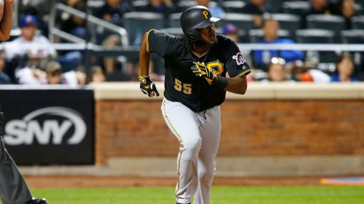 NEW YORK, NY - JUNE 02:  Josh Bell #55 of the Pittsburgh Pirates watches the flight of his sixth inning home run against the New York Mets at Citi Field on June 2, 2017 in the Flushing neighborhood of the Queens borough of New York City.  (Photo by Jim McIsaac/Getty Images)