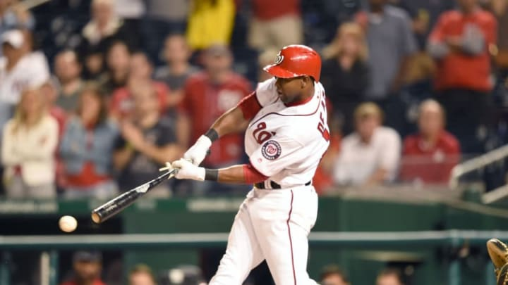 WASHINGTON, DC - SEPTEMBER 28:  Alejandro De Aza #17 of the Washington Nationals gets a game-winning hit to score Anthony Rendon #6 in the ninth inning during a baseball game against the Pittsburgh Pirates at Nationals Park on September 28, 2017 in Washington, DC.  (Photo by Mitchell Layton/Getty Images)