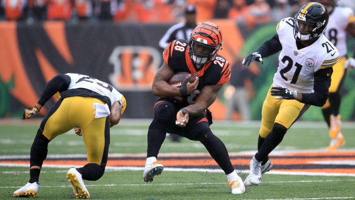 CINCINNATI, OH - OCTOBER 14:  Joe Haden #23 of the Pittsburgh Steelers attempts to tackle Joe Mixon #28 of the Cincinnati Bengals during the first quarter at Paul Brown Stadium on October 14, 2018 in Cincinnati, Ohio. (Photo by Andy Lyons/Getty Images)