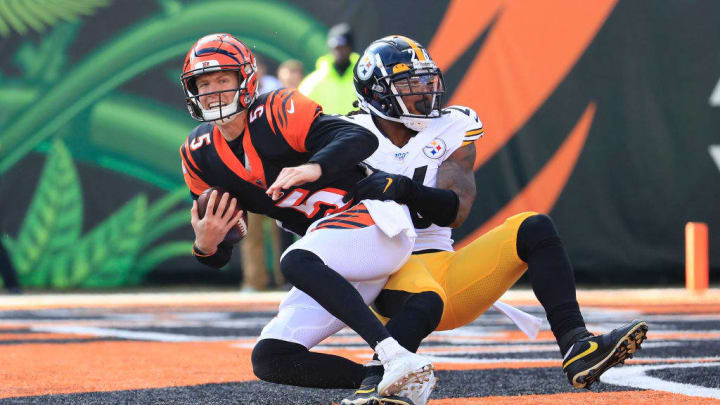 CINCINNATI, OHIO - NOVEMBER 24:  Ryan Finley #5 of the Cincinnati Bengals is sacked by Mark Barron #26 of the Pittsburgh Steelers during the game at Paul Brown Stadium on November 24, 2019 in Cincinnati, Ohio. (Photo by Andy Lyons/Getty Images)