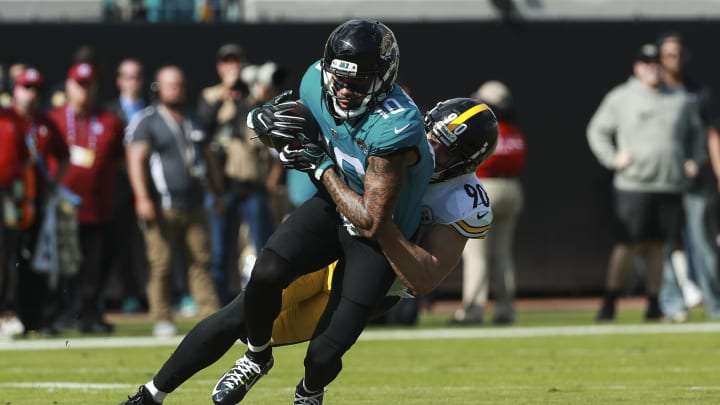 JACKSONVILLE, FL - NOVEMBER 18: Donte Moncrief #10 of the Jacksonville Jaguars is tackled by T.J. Watt #90 of the Pittsburgh Steelers during the first half at TIAA Bank Field on November 18, 2018 in Jacksonville, Florida.  (Photo by Scott Halleran/Getty Images)