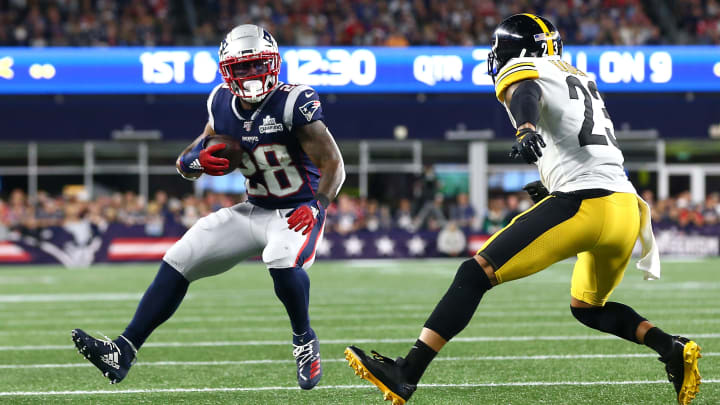FOXBOROUGH, MASSACHUSETTS - SEPTEMBER 08: Joe Haden #23 of the Pittsburgh Steelers attempts to tackle James White #28 of the New England Patriots during the first half at Gillette Stadium on September 08, 2019 in Foxborough, Massachusetts. (Photo by Maddie Meyer/Getty Images)