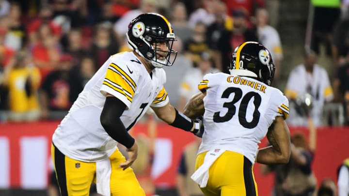 TAMPA, FL - SEPTEMBER 24: Ben Roethlisberger #7 hands the ball off to James Conner #30 in the third quarter in a game against the Tampa Bay Buccaneers on September 24, 2018 at Raymond James Stadium in Tampa, Florida. (Photo by Julio Aguilar/Getty Images)