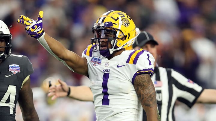 GLENDALE, ARIZONA - JANUARY 01: Wide receiver Ja'Marr Chase #1 of the LSU Tigers gestures during the second quarter of the PlayStation Fiesta Bowl between LSU and Central Florida at State Farm Stadium on January 01, 2019 in Glendale, Arizona. (Photo by Christian Petersen/Getty Images)