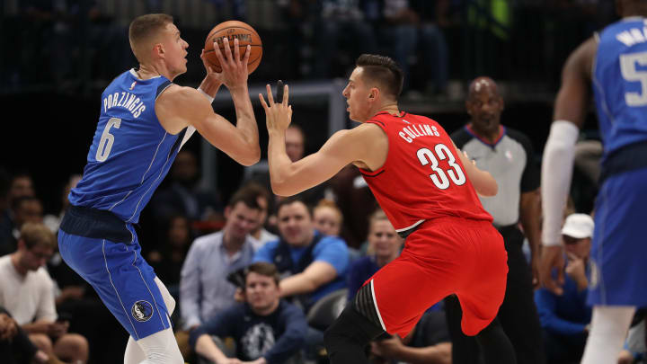 DALLAS, TEXAS - OCTOBER 27:  Kristaps Porzingis #6 of the Dallas Mavericks and Zach Collins #33 of the Portland Trail Blazers in the second half at American Airlines Center on October 27, 2019 in Dallas, Texas. NOTE TO USER: User expressly acknowledges and agrees that, by downloading and or using this photograph, User is consenting to the terms and conditions of the Getty Images License Agreement.  (Photo by Ronald Martinez/Getty Images)