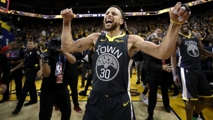 OAKLAND, CALIFORNIA - MAY 16:   Stephen Curry #30 of the Golden State Warriors celebrates after defeating the Portland Trail Blazers 114-111 in game two of the NBA Western Conference Finals at ORACLE Arena on May 16, 2019 in Oakland, California.  NOTE TO USER: User expressly acknowledges and agrees that, by downloading and or using this photograph, User is consenting to the terms and conditions of the Getty Images License Agreement. (Photo by Ezra Shaw/Getty Images)