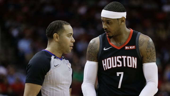HOUSTON, TX - OCTOBER 30:  Carmelo Anthony #7 of the Houston Rockets talks with referee Jonathan Sterling after being called for a foul during the second quarter Portland Trail Blazers at Toyota Center on October 30, 2018 in Houston, Texas. NOTE TO USER: User expressly acknowledges and agrees that, by downloading and or using this photograph, User is consenting to the terms and conditions of the Getty Images License Agreement.  (Photo by Bob Levey/Getty Images)