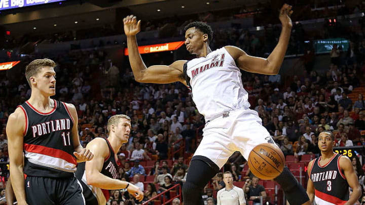 MIAMI, FL - DECEMBER 20:  Hassan Whiteside #21 of the Miami Heat  dunks during a game against the Portland Trail Blazers at American Airlines Arena on December 20, 2015 in Miami, Florida. NOTE TO USER: User expressly acknowledges and agrees that, by downloading and/or using this photograph, user is consenting to the terms and conditions of the Getty Images License Agreement. Mandatory copyright notice:  (Photo by Mike Ehrmann/Getty Images)