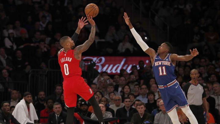 Damian Lillard shooting over Knicks' Frank Ntilikina