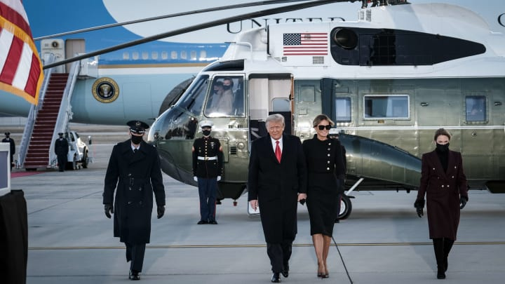 Donald Trump and Melania Trump exit Marine Force One.
