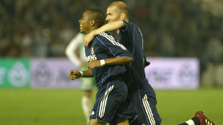 Real Madrid's Brazilian Robinho (L) cele