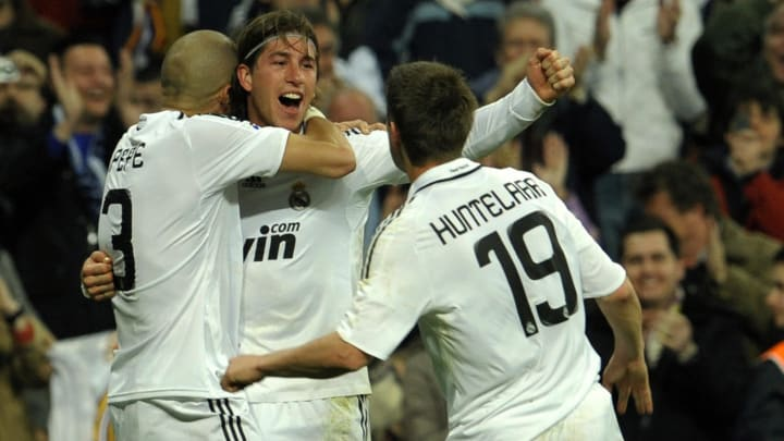 Real Madrid's Sergio Ramos (C) is congra