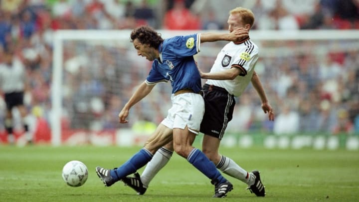 Matthias Sammer crunches into a challenge against Italy