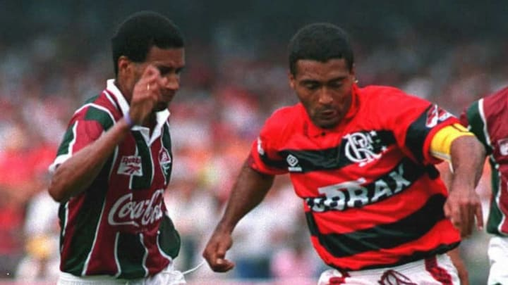 Romario (R), playing his first game with his new c