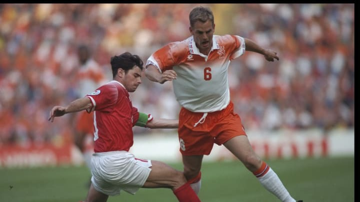 Ronald De Boer of Holland (right) is tackled by Ciriaco Sforza of Switzerland (left)