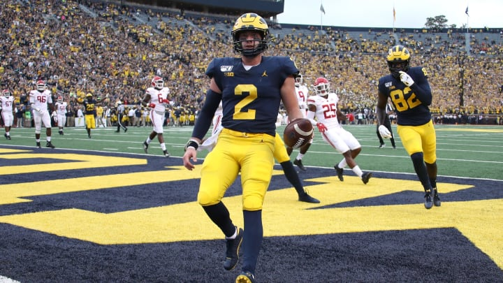 ANN ARBOR, MICHIGAN - SEPTEMBER 28: Shea Patterson #2 of the Michigan Wolverines scores a first quarter touchdown while playing the Rutgers Scarlet Knights at Michigan Stadium on September 28, 2019 in Ann Arbor, Michigan. (Photo by Gregory Shamus/Getty Images)
