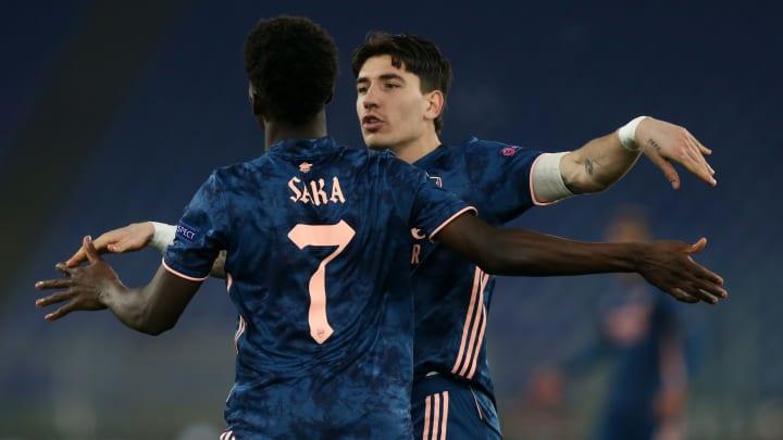 Saka celebrates his equaliser with Bellerin