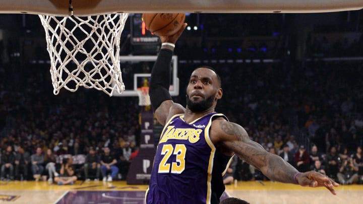LOS ANGELES, CA - NOVEMBER 15: LeBron James #23 of the Los Angeles Lakers dunks over Nemanja Bjelica #88 of the Sacramento Kings during the first half at Staples Center on November 15, 2019 in Los Angeles, California. NOTE TO USER: User expressly acknowledges and agrees that, by downloading and/or using this Photograph, user is consenting to the terms and conditions of the Getty Images License Agreement. (Photo by Kevork Djansezian/Getty Images)