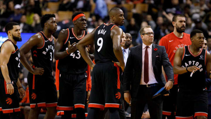 TORONTO, ON - NOVEMBER 06: Toronto Raptors Head Coach Nick Nurse stands amongst his team, (L-R) Fred VanVleet #23, OG Anunoby #3, Pascal Siakam #43, Serge Ibaka #9 and Kyle Lowry #7 as a call is disputed during second half of their NBA game against the Sacramento Kings at Scotiabank Arena on November 6, 2019 in Toronto, Canada. NOTE TO USER: User expressly acknowledges and agrees that, by downloading and or using this photograph, User is consenting to the terms and conditions of the Getty Images License Agreement. (Photo by Cole Burston/Getty Images)