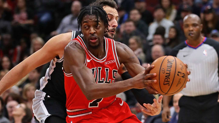 CHICAGO, ILLINOIS - NOVEMBER 26: Justin Holiday #7 of the Chicago Bulls drives past Marco Belinelli #18 of the San Antonio Spurs at the United Center on November 26, 2018 in Chicago, Illinois. NOTE TO USER: User expressly acknowledges and agrees that, by downloading and or using this photograph, User is consenting to the terms and conditions of the Getty Images License Agreement. (Photo by Jonathan Daniel/Getty Images)