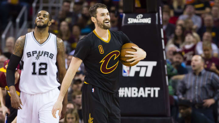 CLEVELAND, OH - JANUARY 21: LaMarcus Aldridge #12 of the San Antonio Spurs and Kevin Love #0 of the Cleveland Cavaliers walk down the court during the second half at Quicken Loans Arena on January 21, 2017 in Cleveland, Ohio. The Spurs defeated the Cavaliers 118-115. NOTE TO USER: User expressly acknowledges and agrees that, by downloading and/or using this photograph, user is consenting to the terms and conditions of the Getty Images License Agreement. Mandatory copyright notice. (Photo by Jason Miller/Getty Images)