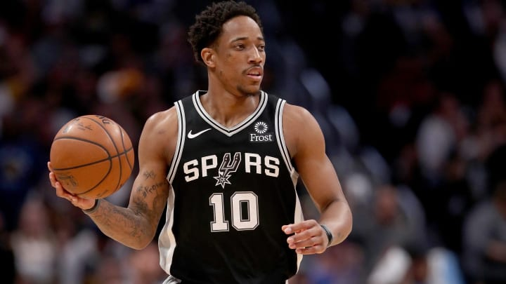DENVER, COLORADO - APRIL 16: Demar DeRozan #10 of the San Antonio Spurs brings the ball down the court against the Denver Nuggets in the second quarter during game two of the first round of the NBA Playoffs at the Pepsi Center on April 16, 2019 in Denver, Colorado. NOTE TO USER: User expressly acknowledges and agrees that, by downloading and or using this photograph, User is consenting to the terms and conditions of the Getty Images License Agreement. (Photo by Matthew Stockman/Getty Images)