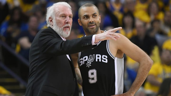 OAKLAND, CA - APRIL 14:  Head coach Gregg Popovich of the San Antonio Spurs talks with his player Tony Parker #9 against the Golden State Warriors in the second quarter during Game One of the first round of the 2018 NBA Playoff at ORACLE Arena on April 14, 2018 in Oakland, California. NOTE TO USER: User expressly acknowledges and agrees that, by downloading and or using this photograph, User is consenting to the terms and conditions of the Getty Images License Agreement.  (Photo by Thearon W. Henderson/Getty Images)