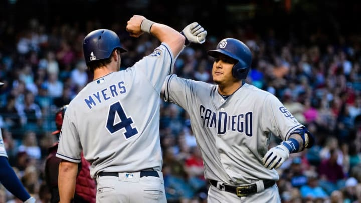 PHOENIX, ARIZONA - SEPTEMBER 28: Manny Machado #13 of the San Diego Padres celebrates a two run home run with teammate Wil Myers #4 in the third inning of the MLB game against the Arizona Diamondbacks at Chase Field on September 28, 2019 in Phoenix, Arizona. (Photo by Jennifer Stewart/Getty Images)