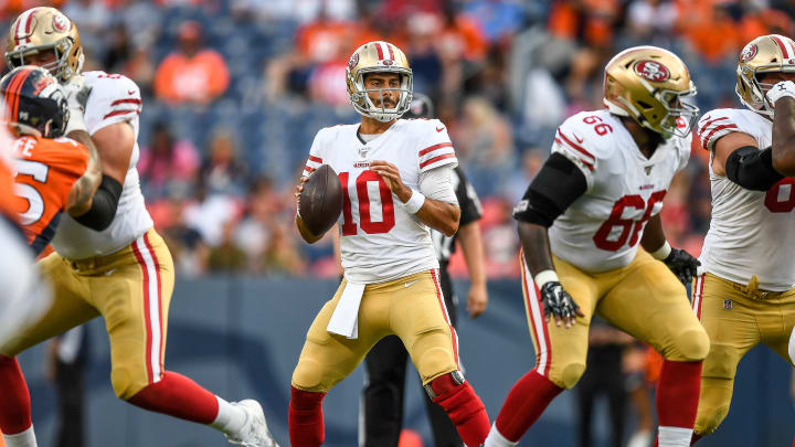 DENVER, CO - AUGUST 19:  Quarterback Jimmy Garoppolo #10 of the San Francisco 49ers sets to pass against the Denver Broncos in the first quarter during a preseason National Football League game at Broncos Stadium at Mile High on August 19, 2019 in Denver, Colorado. (Photo by Dustin Bradford/Getty Images)