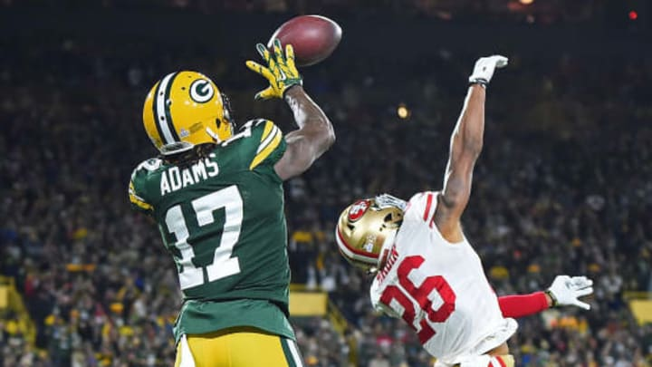 GREEN BAY, WI - OCTOBER 15:  Davante Adams #17 of the Green Bay Packers catches a pass for a touchdown in front of Greg Mabin #26 of the San Francisco 49ers during the second half at Lambeau Field on October 15, 2018 in Green Bay, Wisconsin.  (Photo by Stacy Revere/Getty Images)