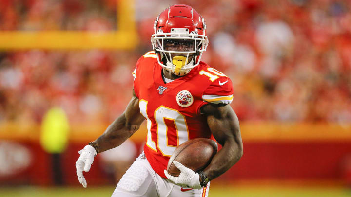 KANSAS CITY, MO - AUGUST 24: Tyreek Hill #10 of the Kansas City Chiefs runs for a 12-yard gain in preseason action against the San Francisco 49ers at Arrowhead Stadium on August 24, 2019 in Kansas City, Missouri. (Photo by David Eulitt/Getty Images)