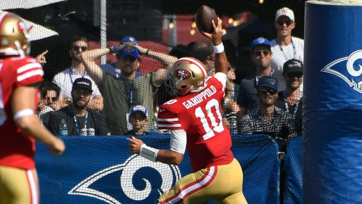 LOS ANGELES, CA - OCTOBER 13: Jimmy Garoppolo #10 of the San Francisco 49ers spikes the ball after a touchdown at the start of the third quarter against the Los Angeles Rams at Los Angeles Memorial Coliseum on October 13, 2019 in Los Angeles, California. (Photo by John McCoy/Getty Images)